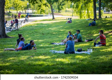 Washington, DC / USA - May 25, 2020: Many people visit the National Mall on Memorial Day, despite the COVID-19 pandemic.