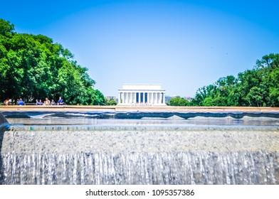 Washington, DC / USA - May 26 2014: Views of the Lincoln Memorial behind the Lincoln Memorial reflacting Pool