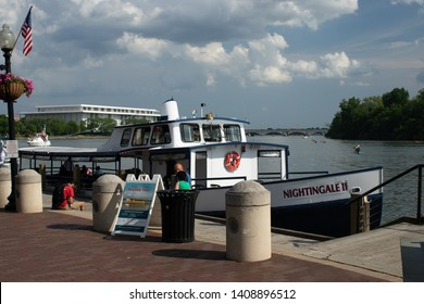 Washington DC USA may 26 2019 Memorial Day Weekend on the Potomac in Georgetown DC. View from the waterfront of tour boats pleasure boats and peple enjoying memorial day weekend in the nations capitol