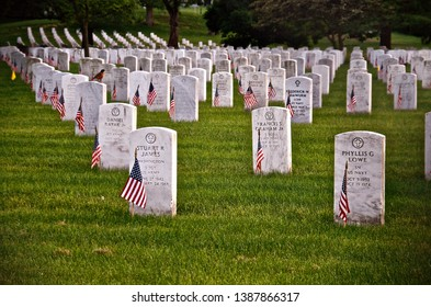 Washington, D.C / USA - May 26th 2014: Honouring the fallen: Gravestones in Arlington Cemetery marked with the US flag on Memorial Day.