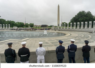 Washington, DC / USA - May 28, 2018: Members of the US Military stand guard at a ceremony at the National World War II Memorial honoring those who served in World War II.