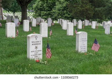 Washington, DC / USA - May 28, 2018: flags are placed at each grave stone at Arlington National Cemetery to pay respects to those military service members who died for our freedom.