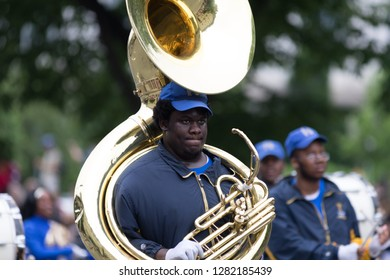 Washington, D.C., USA - May 28, 2018: The National Memorial Day Parade, Members of the Ballou H.S. Marching Knights, marching down Constitution Avenue