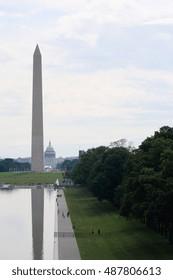 Washington DC, USA - May 28, 2016: Washington Monument seen from the Lincoln Memorial while tourist walk around.