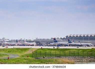 WASHINGTON DC, USA - MAY 3, 2015: Aircrafts of American Airlines and US Airways in the movement area of Ronald Reagan National Airport seen from Gravelly Point Park.