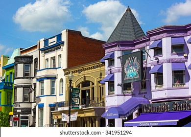 WASHINGTON DC, USA -?? MAY 9, 2015: Street with restaurants and clubs in Adams Morgan neighborhood on May 9, 2015 in Washington DC. Sunny spring day on the street of a vibrant city neighborhood.