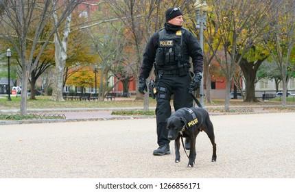 WASHINGTON DC, USA - NOV 24, 2018: Policeman with dog near White House