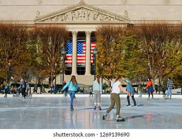 WASHINGTON DC, USA - NOV 25, 2018: National Gallery of Art Sculpture Garden Ice Rink. People