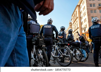 Washington, DC, USA - November 13, 2020: Metropolitan (DC) Police stand by as Trump supporters and white supremacists harass anti-racism protesters and deface the memorial at Black Lives Matter Plaza