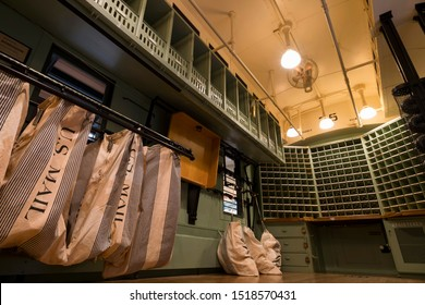 Washington DC, USA - November 24, 2018: U.S. mail bags seen in a mail train car with letter slots called 'pigeon holes'.