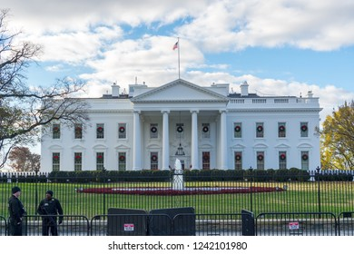 Washington, DC / USA - November 27, 2018: The White House is decorated for Christmas with wreaths on the windows.