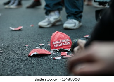Washington, DC, USA - November 3, 2020. A broken Make America Great Again hat lies on the road on Election Day.