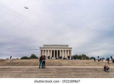 Washington DC, USA - November 30, 2019: People walking nearby the Lincoln Memorial on the National Mall