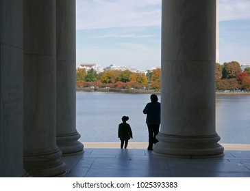 Washington D.C., USA, November 4, 2017: Woman and girl on the steps of the Jefferson Memorial, looking over the Tidal Basin towards the Washington Monument