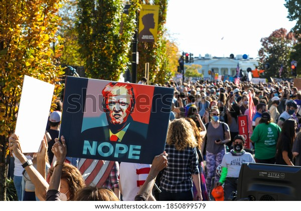 Washington, DC, USA / November 7, 2020. People gather at Black Lives Matter Plaza near the White House to celebrate after Joe Biden is announced President-Elect.