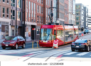 Washington DC, USA - October 12, 2018: Capital red bus Metrobus metro trolley cable car tram public transport vehicle on Capitol hill H street in city road