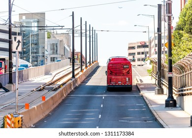 Washington DC, USA - October 12, 2018: Capital red bus Metrobus metro public transportation vehicle on Capitol hill H street in city road