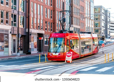Washington DC, USA - October 12, 2018: Capital red bus Metrobus metro tram trolley cable car public transport vehicle on Capitol hill H street in city road