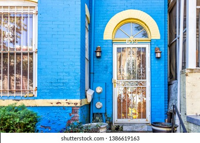 Washington DC, USA - October 12, 2018: Colorful blue painted brick residential townhouse home house architecture exterior in Washington DC Capitol Hill neighborhood district
