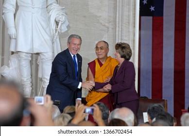 Washington DC, USA, October 17, 2007   Speaker Nancy Pelosi shakes hands  with The 14th Dalia Lama Lhamo Dondrub of Tibet in the Rotunda of the US Capital as President George W. Bush looks on