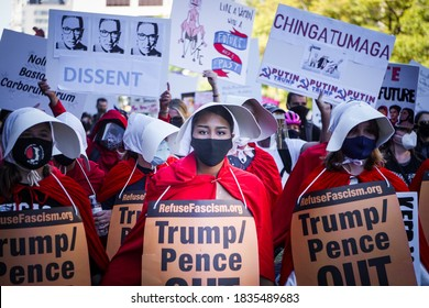 WASHINGTON D.C., USA - OCTOBER 17, 2020: Women dressed as handmaids stand in front of the crowd at the Women's March to protest the nomination of Amy Coney Barrett.