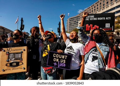 Washington, DC, USA - October 17, 2020: Washington Black Lives Matter activists raise their fists and cheer a colleague who is speaking to the Women's March