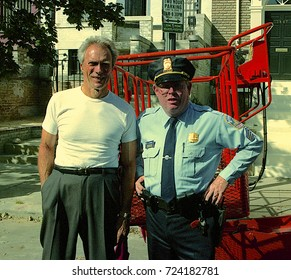 Washington DC. USA, October, 1992 Clint Eastwood playing the part of Secret Service Agent Frank Horrigan during a break in filming poses with a real DC. police officer.