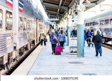Washington DC, USA - October 27, 2017: Union station railway platform with VRE and Amtrack trains from Virginia for commute during morning with many people walking at arrival