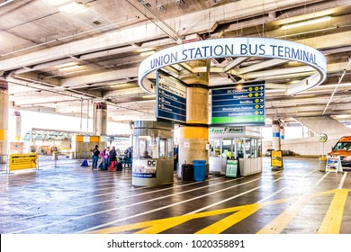Washington DC, USA - October 27, 2017: Inside Union Station parking garage for buses in capital city with closeup of direction signs, people walking
