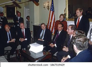 Washington DC. USA, October 27, 1990 Senate Minority Leader Bob Dole (R-KS) (C) along with other senators and White House staffers including Chief of Staff John Sununu with a copy of the budget