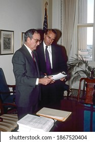 Washington DC. USA, October 27, 1990 Senate Majority Leader George Mitchell (D-ME) with Senate Minority Leader Robert Dole (R-KS) count up the expected votes prior to the final vote on the budget bill