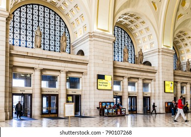 Washington DC, USA - October 27, 2017: Inside Union Station in capital city with people walking inside entrance, tall ceilings and architecture