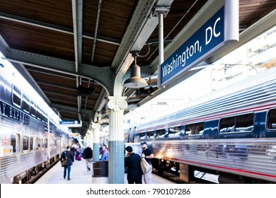 Washington DC, USA - October 27, 2017: Union station railway platform with VRE and Amtrack trains from Virginia for commute during morning with many people walking at arrival, sign closeup