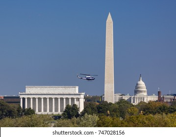WASHINGTON, DC, USA - OCTOBER 31, 2017: Helicopter flies by Lincoln Memorial, Washington Monument, U.S. Capitol (L-R).