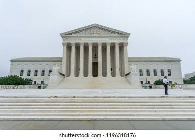 Washington, DC/ USA - October 6, 2018: A Supreme Court policeman walks in front of the US Supreme Court as protests are expected during the confirmation process of Brett Kavanaugh
