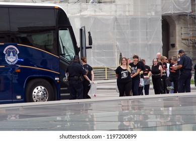 Washington, DC / USA - October 6, 2018: Arrested protestors are detained and led into a bus outside the US Capitol after storming its steps to protest the confirmation of Judge Brett Kavanaugh