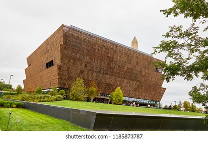 Washington DC, USA - September 14, 2018: National Museum of African American History and Culture exterior street view with Washington Monument in the background