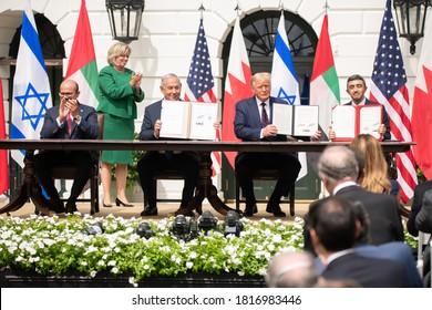 Washington DC, USA - September 15, 2020: Benjamin Netanyahu, Donald Trump, Abdullatif bin Rashid Al Zayani, and Abdullah bin Zayed Al Nahyan attend the Abraham Accords ceremony in The White House.