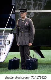 "Washington DC. USA, September, 1989 US. Marine Major John Kline serving as one the Military Aides to the White House stands ready to board Marine One with  the ""Football."""