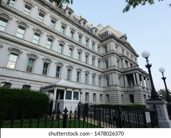 Washington, D.C. USA- September 2017: Side view shot of the façade of the Dwight D. Eisenhower Executive Office building framed by trees in Washington, D.C.