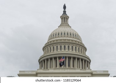 Washington, DC / USA - September 21, 2018: the POW/MIA Flag flies over the US Capitol for National POW/MIA Recognition Day.