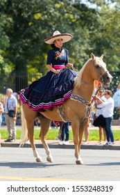 Washington DC, USA - September 21, 2019: The Fiesta DC, Mexican woman wearing traditional charro clothing, riding horse during the parade