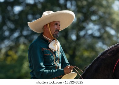 Washington DC, USA - September 21, 2019: The Fiesta DC, Mexican man wearing traditional charro clothing, riding horse during the parade