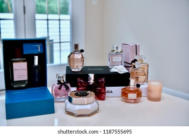 WASHINGTON DC, USA - SEPTEMBER 24, 2018: Luxury fragrance bottles sitting on a desk.