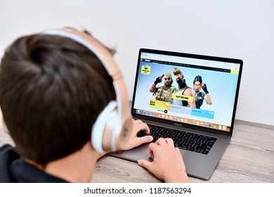 WASHINGTON DC, USA - SEPTEMBER 24, 2018: A teenage boy is playing the popular Fortnite game on a MacBook Pro laptop.