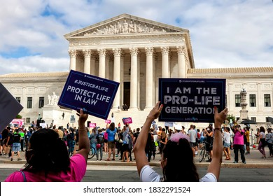 Washington, DC, USA - September 27, 2020: A few pro-life counter-protesters attended the No Confirmation Until Inauguration Rally at the Supreme Court against replacing RBG before the election