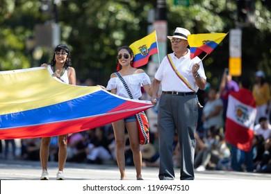 Washington, D.C., USA - September 29, 2018: The Fiesta DC Parade, Men and women holding a giant Ecuadorian flag