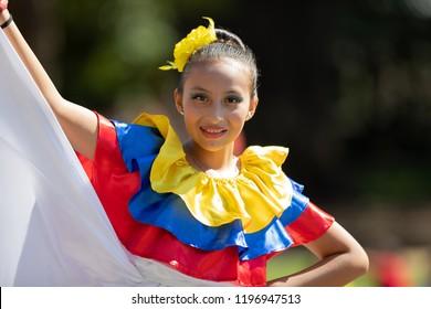 Washington, D.C., USA - September 29, 2018: The Fiesta DC Parade, Young women wearing traditional ecuadorian clothing dancing