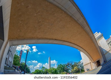 WASHINGTON DC, USA - SEPTEMBER 5, 2018: The famous Wilson and Knap recognition memorial arch at Department of Agriculture. George Washington monument in background.