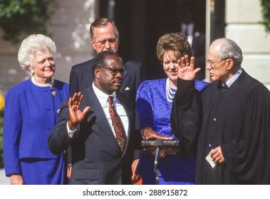 WASHINGTON, DC, USA - U. S. Supreme Court Justice Clarence Thomas sworn in White House. L-R: Barbara Bush, President Bush, Thomas, wife Virginia Lamp Thomas, Justice Byron White. October 18, 1991